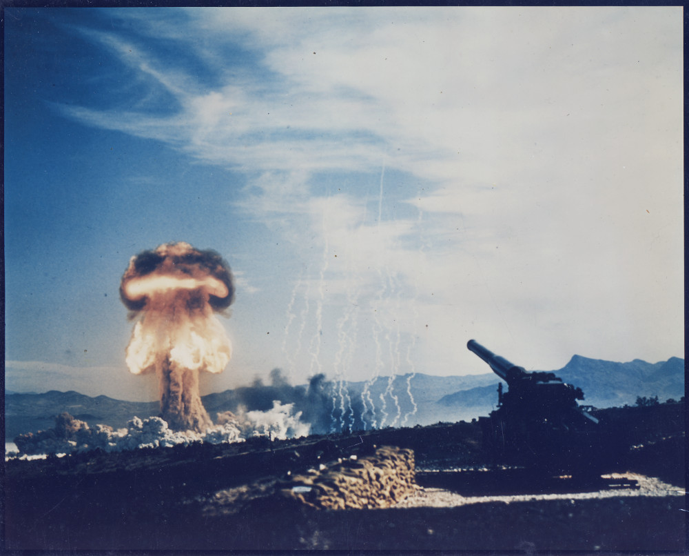 Frenchman's Flat, Nevada - Atomic Cannon Test - History's first atomic artillery shell fired from the Army's new 280-mm artillery gun. Hundreds of high ranking Armed Forces officers and members of Congress are present. The fireball ascending