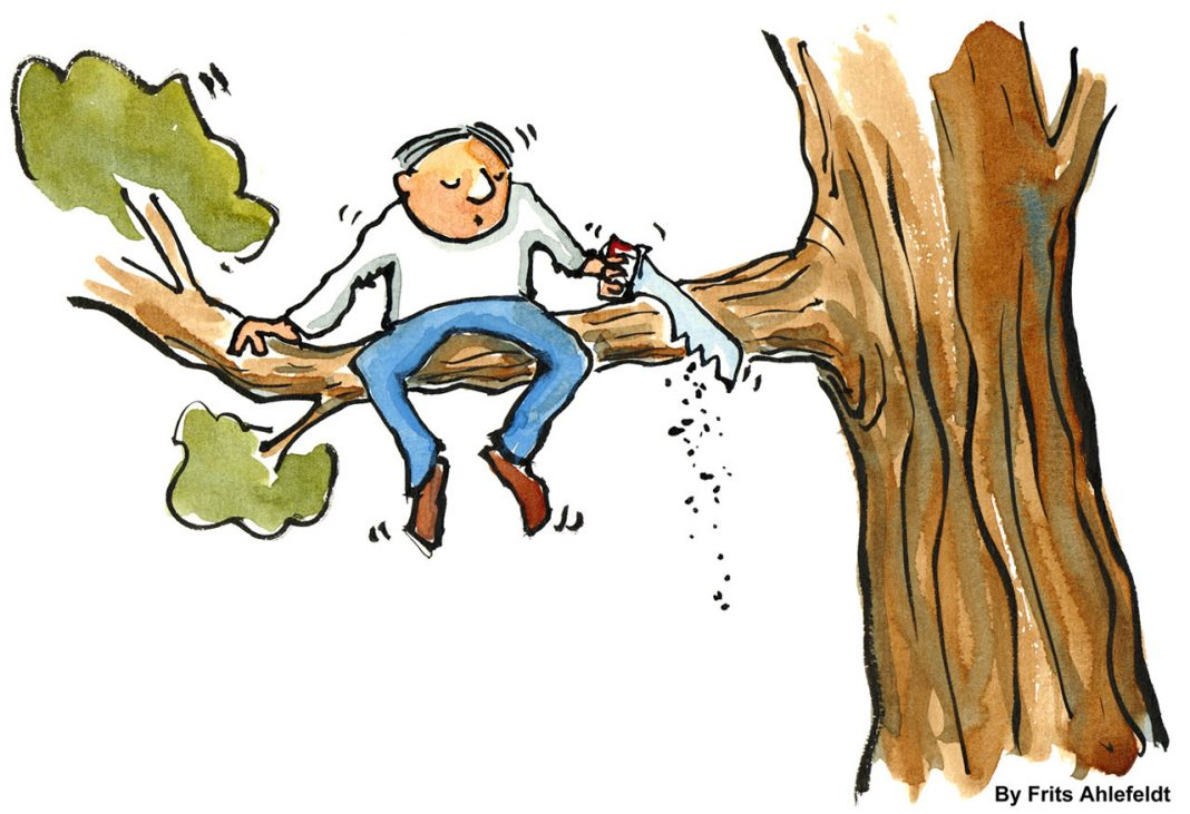 Man cutting of the branch he is sitting on
