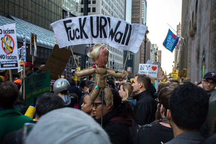 Protests in New York City on April 14, 2016. One banner reads