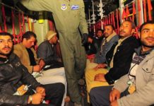 Egyptian refugees travel aboard a U.S. Air Force C-130J Super Hercules