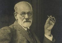 portrait of a seated Sigmund Freud