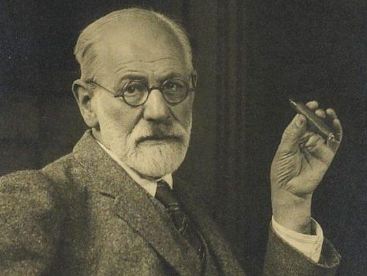portrait of a seated Sigmund Freud